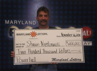 Lottery winner collects — in style