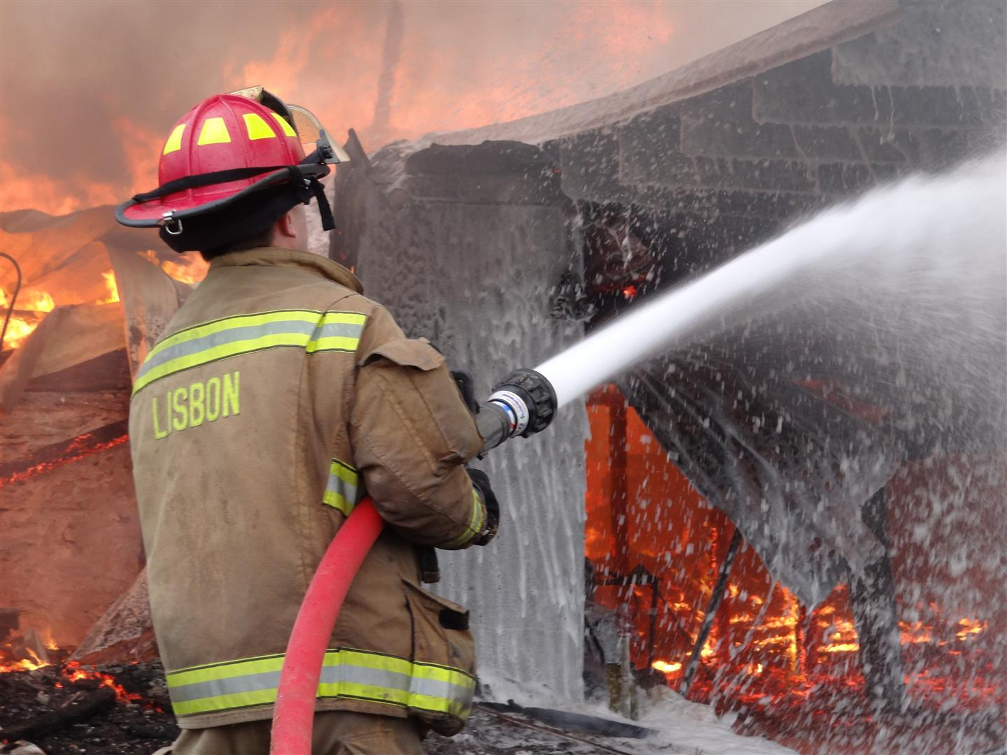 More than 60 firefighters team to fight barn fire in Woodbine