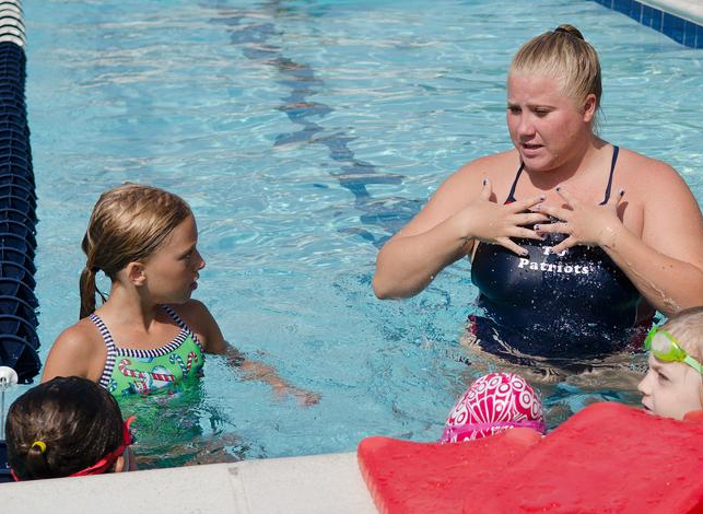 Signed in: Coaches learn sign language to help young swimmers