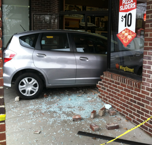 Car Crashes Into Business