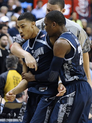 No. 7 Georgetown beats Connecticut 79-78 in 2 OTs