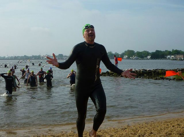 Business Journal reporter fighting cancer completes Ironman Triathlon