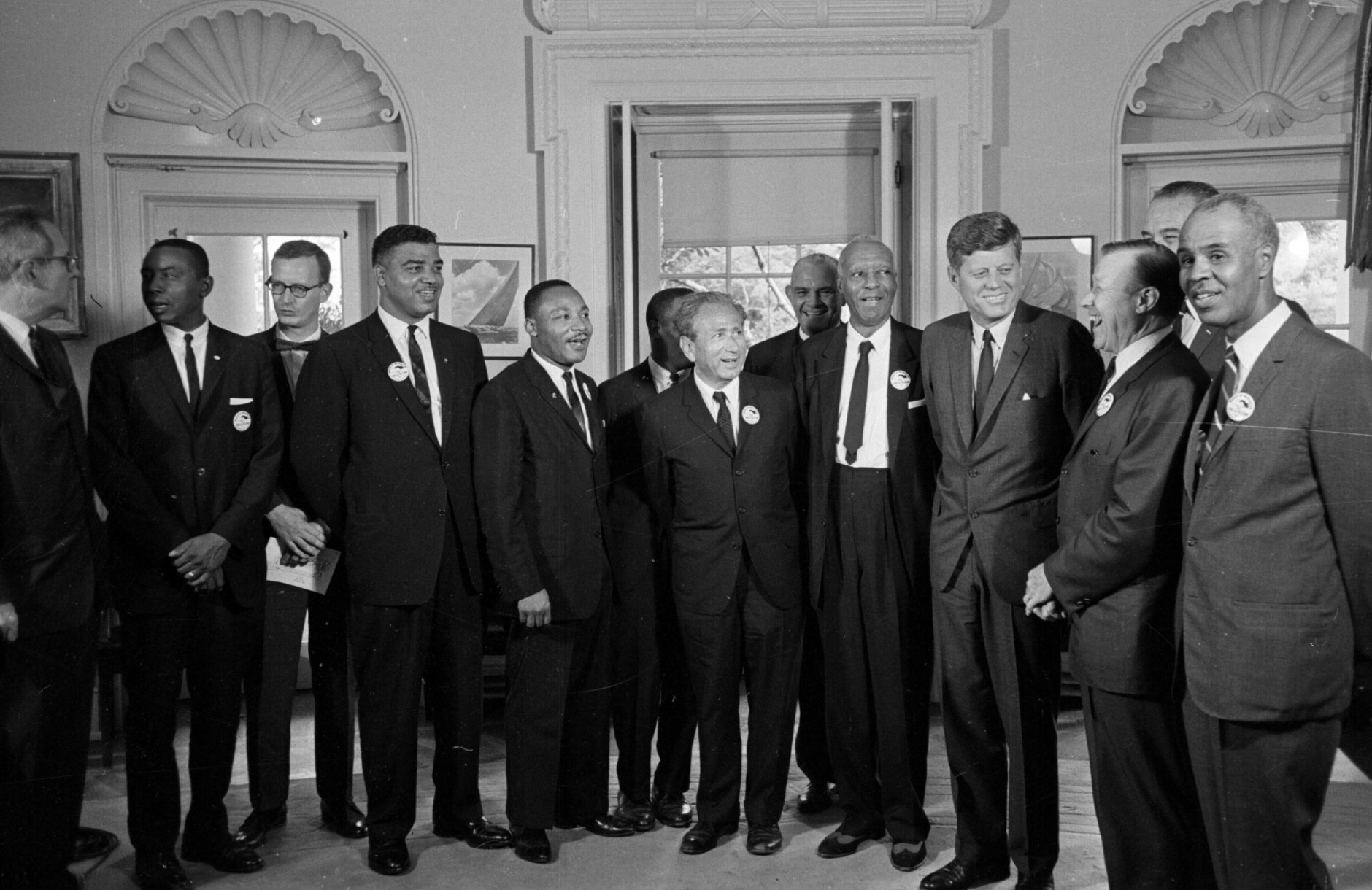 President Kennedy poses August 28, 1963 at the White House with a group of leaders of the March on Washington.  From left, Whitney Young, National Urban League; Dr. Martin Luther King, Christian Leadership Conference; John Lewis, Student Non-violent Coordinating Committee;  Rabbi Joachim Prinz, American Jewish Congress; Dr. Eugene P. Donnaly, National Council of Churches; A. Philip Randolph, AFL-CIO vice president; Kennedy; Walter Reuther, Unidted Auto Workers; Vice-President Johnson, rear, and Roy Wilkins, NAACP. (AP Photo)