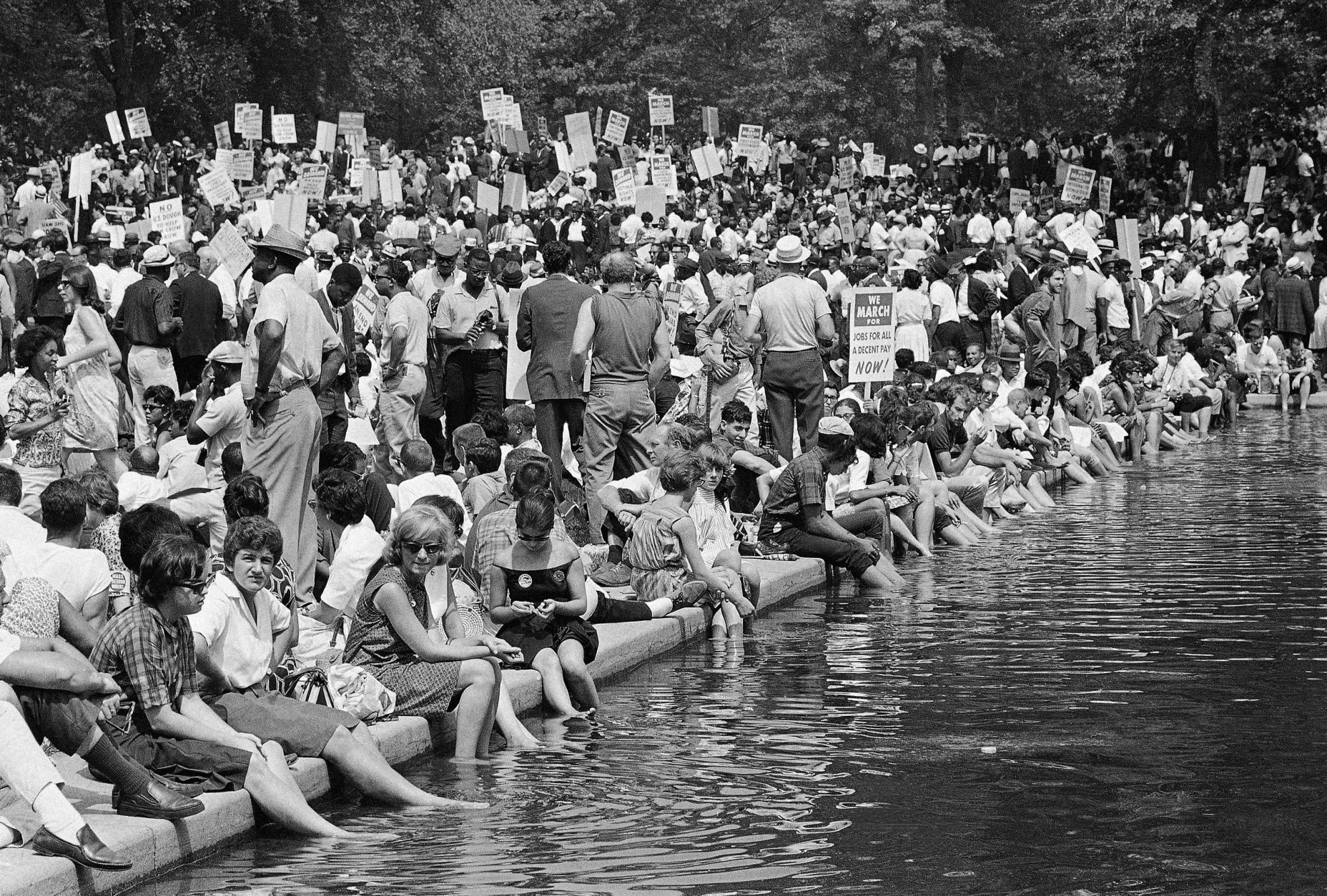 A crowd gathers near the reflecting pool in Washington, Aug. 28, 1963, to hear speakers in ceremonies following the March on Washington parade through the Capitol streets. (AP Photo)
