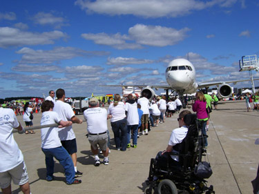 Athletes pull together for Special Olympics at Dulles Airport