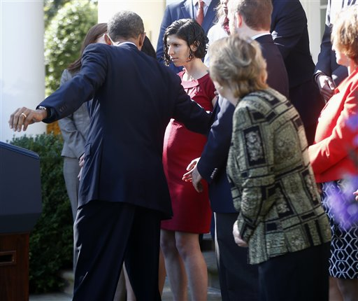 Obama helps woman during health care speech