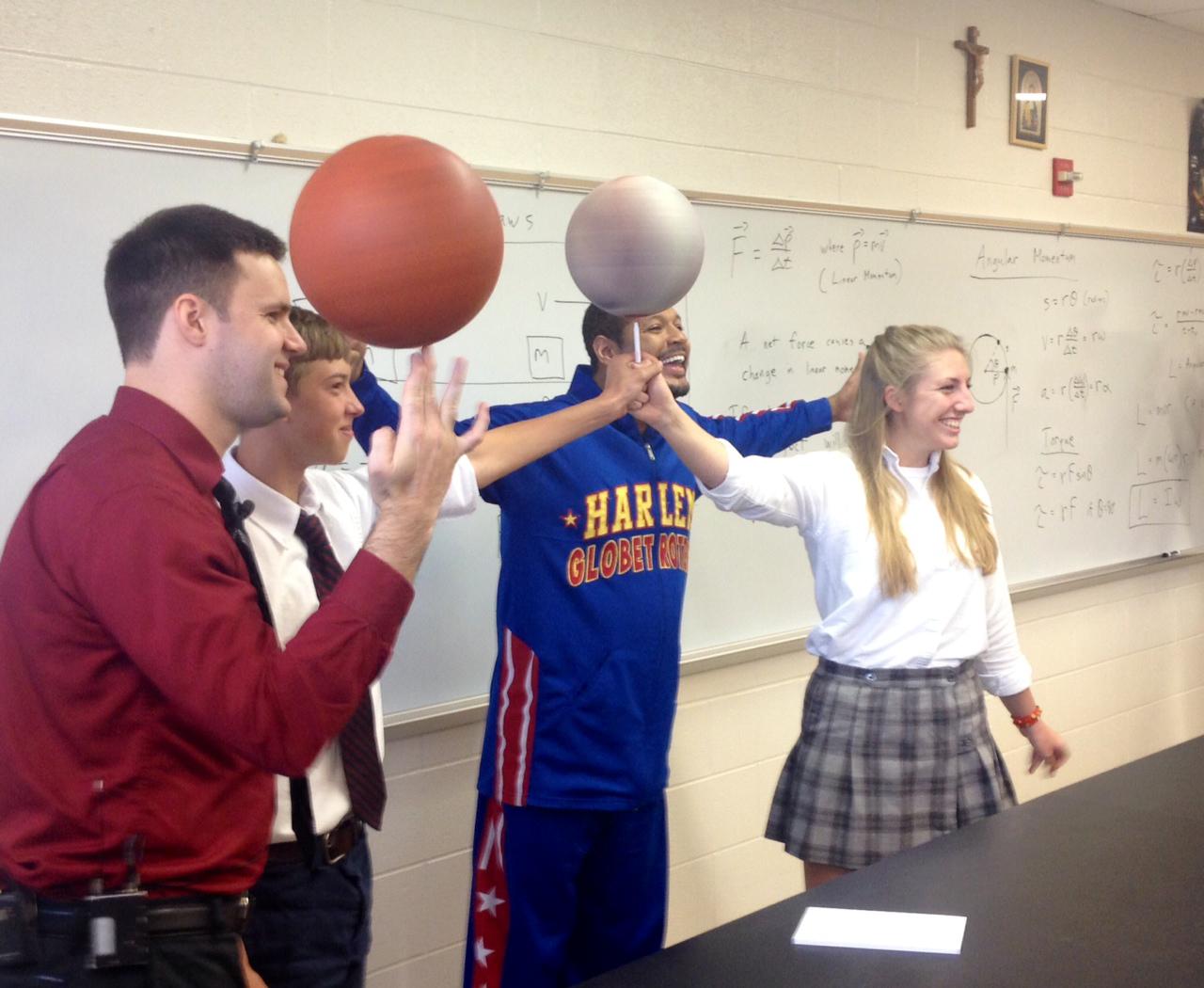 Harlem Globetrotter visits D.C. physics teacher with spin skills