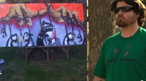 Veteran uses spray paint to heal battlefield scars (Video)