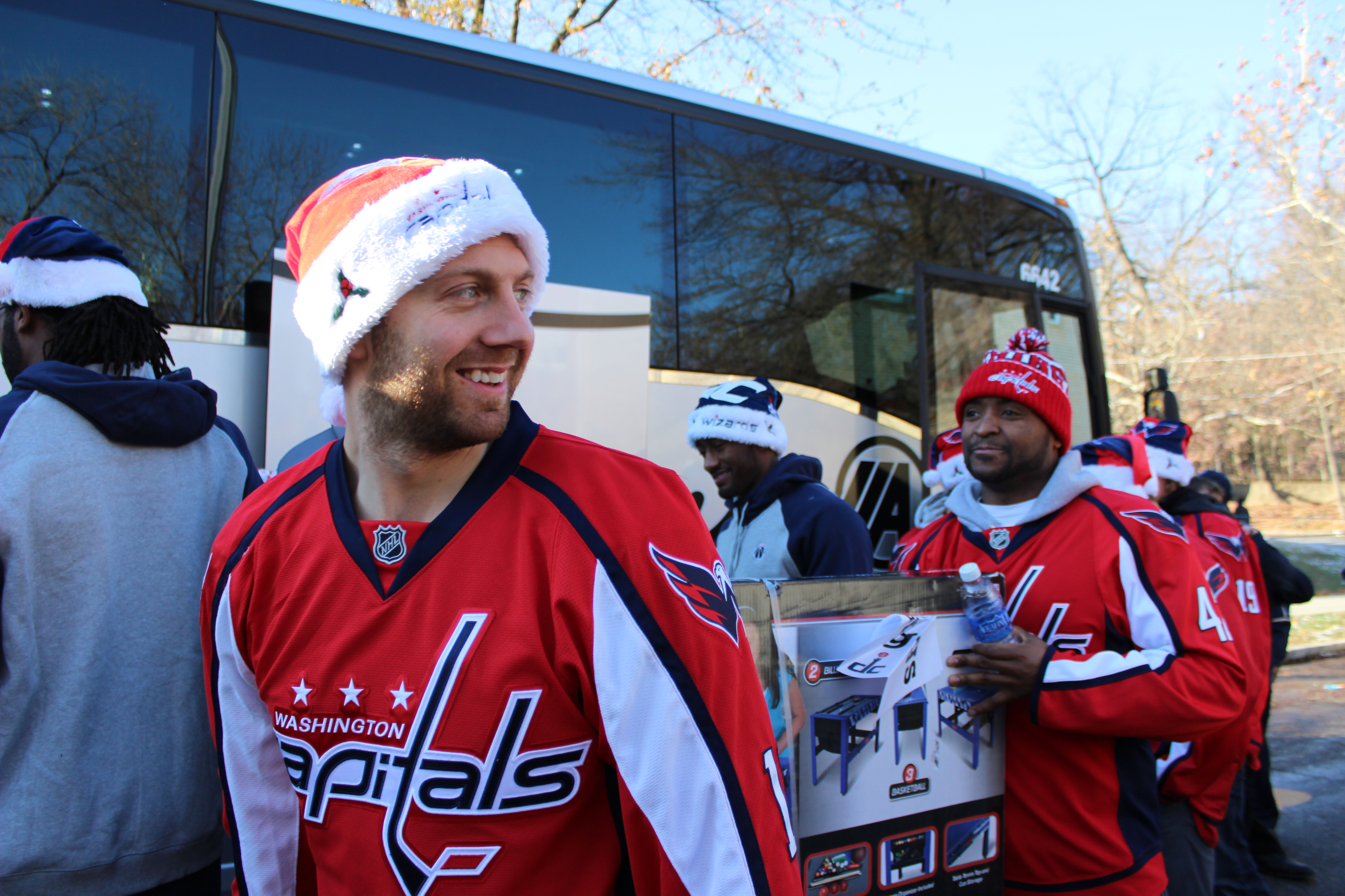 Capitals and Wizards players hand out gifts to D.C. families