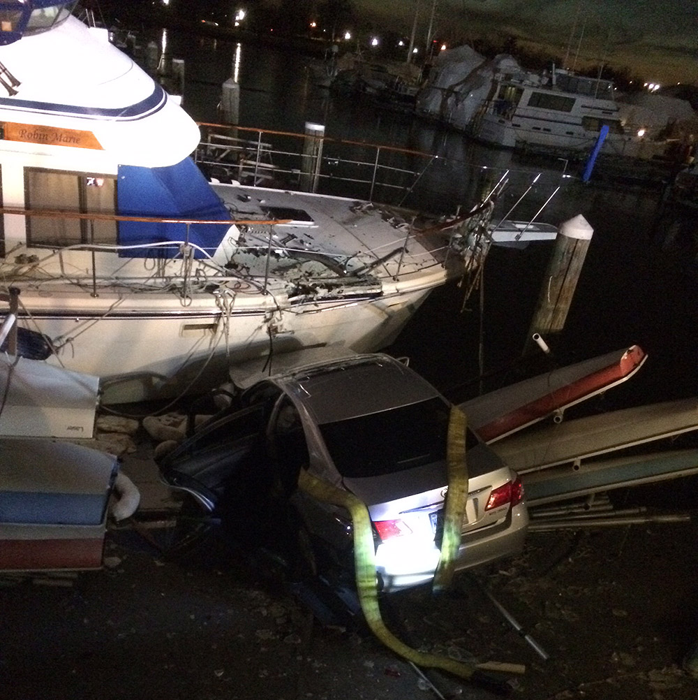 1 injured after car crashes into boat along Southwest Waterfront