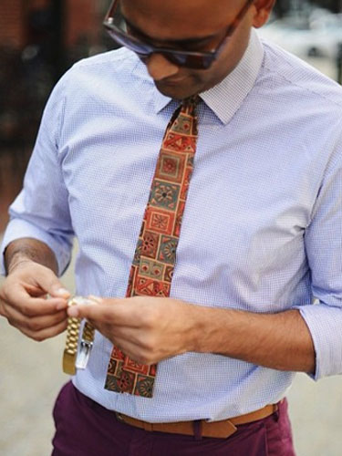 In a business casual world, what happens to the tie?
