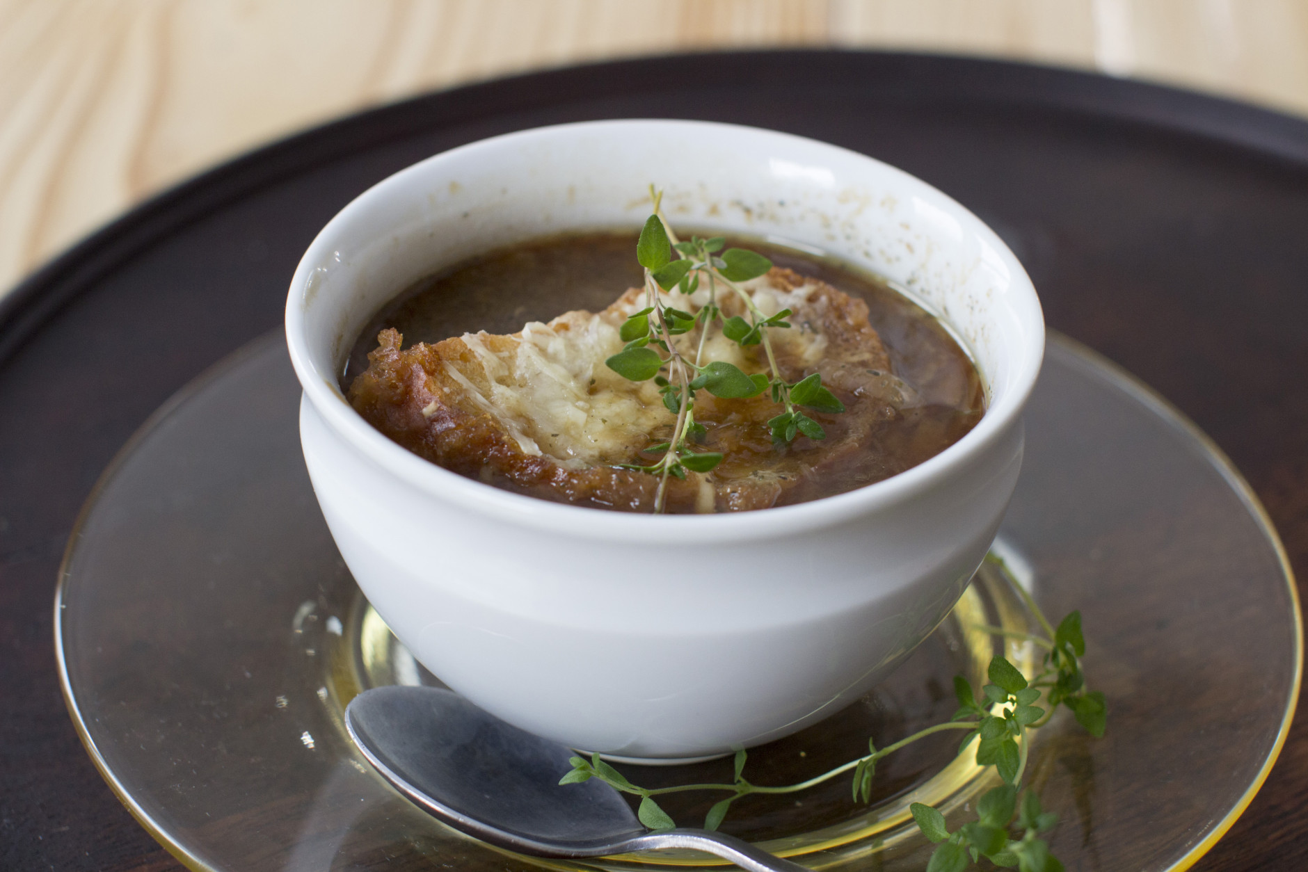 This Dec. 1, 2014 photo shows slow cooker onion soup in Concord, N.H. The humble onion is one the most common aromatic vegetables, popping up in so many ways across so many cuisines. (AP Photo/Matthew Mead)