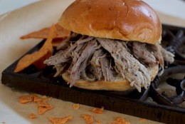 This Jan. 25, 2016 photo shows 6-ingredient slow cooker pulled pork in Concord, N.H. This dish is from a recipe by Katie Workman. (AP Photo/Matthew Mead)