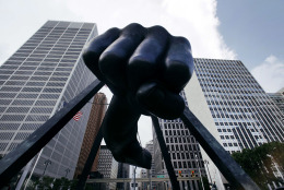 "In this July 18, 2013 file photo, the Detroit skyline rises behind the Monument to boxer Joe Louis, also known as ""The Fist."" The sculpture is an icon in Detroit's downtown, which is in the very early stages of recovery following finalization of the city's bankruptcy. (AP Photo/Paul Sancya)"
