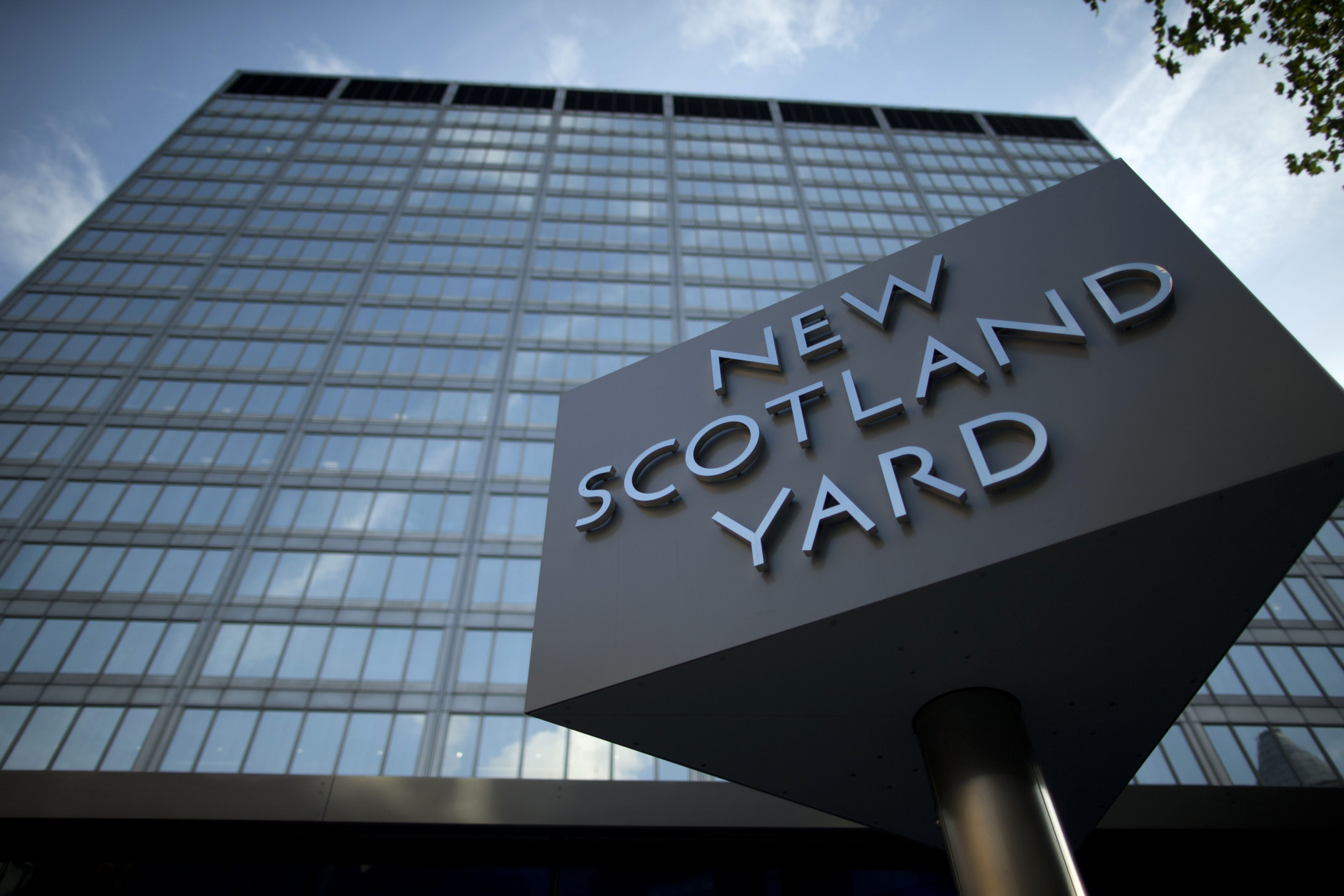 FILE - A Tuesday, Oct. 30, 2012 photo from files showing the sign outside New Scotland Yard, the headquarters building of London's Metropolitan Police force in central London. Scotland Yard, the world's most famous police headquarters, has been sold to Gulf investors who plan to turn it into luxury apartments. The London mayor's office said Tuesday that Abu Dhabi Financial Group had bought the site for 370 million pounds ($580 million), 120 million pounds over the asking price. (AP Photo/Matt Dunham, File)