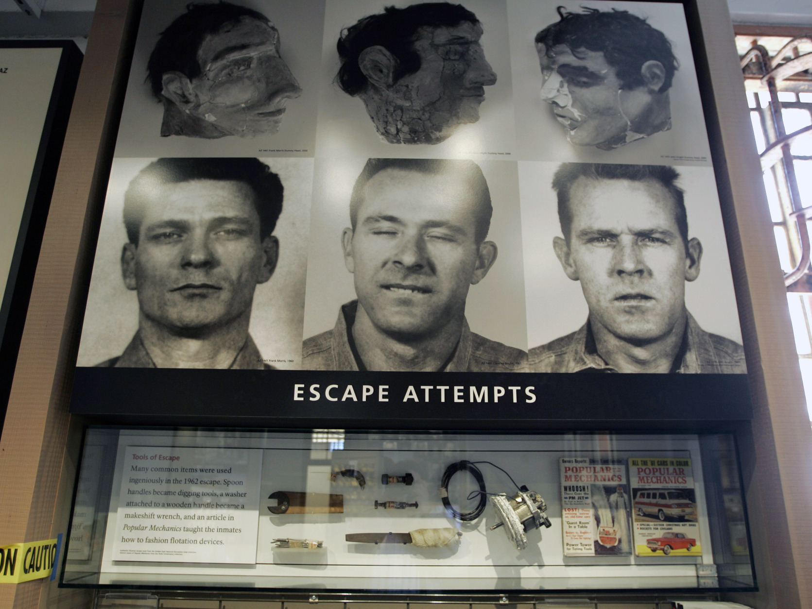 "FILE - In this April 24, 2007, file photo, an exhibit about a 1962 prison escape made famous in the movie, ""Escape from Alcatraz,"" is displayed in the museum store on Alcatraz Island in San Francisco. Scientists say the three prisoners who escaped from Alcatraz in one of the most famous and elaborate prison breaks in U.S. history could have survived and made it to land. Using software to study currents the night of the 1962 escape, three Dutch scientists concluded the three men could have made it to land north of the Golden Gate Bridge if they left between 11:30 p.m. and midnight.  Prison officials and federal agents insisted at the time that the inmates perished, but their bodies were never found.(AP Photo/Eric Risberg, File)"