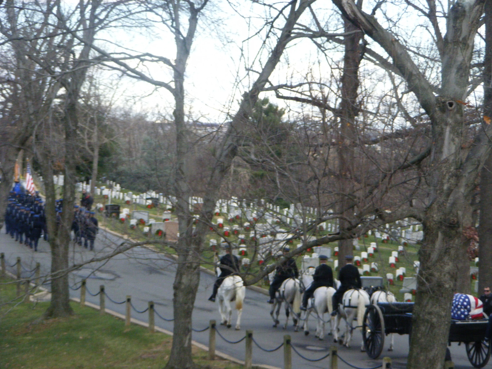 A horse-drawn carriage brings Don Sheda's casket to its final resting place.