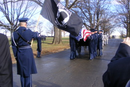 Don Sheda's body is carried to its resting place.