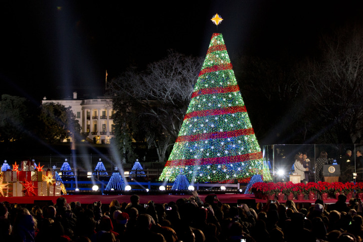 President Barack Obama and the first family stands, right, after lighting  the 2014 National Christmas Tree during the National Christmas Tree lighting . - Prepare For Thursday's Christmas Tree Lighting Road Closures WTOP