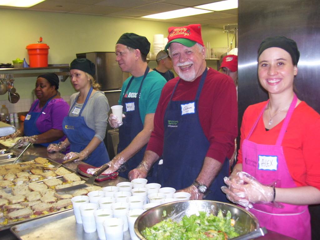 Volunteers prepare and service Christmas breakfast at D.C.'s Miriam's Kitchen. (WTOP/Kathy Stewart)
