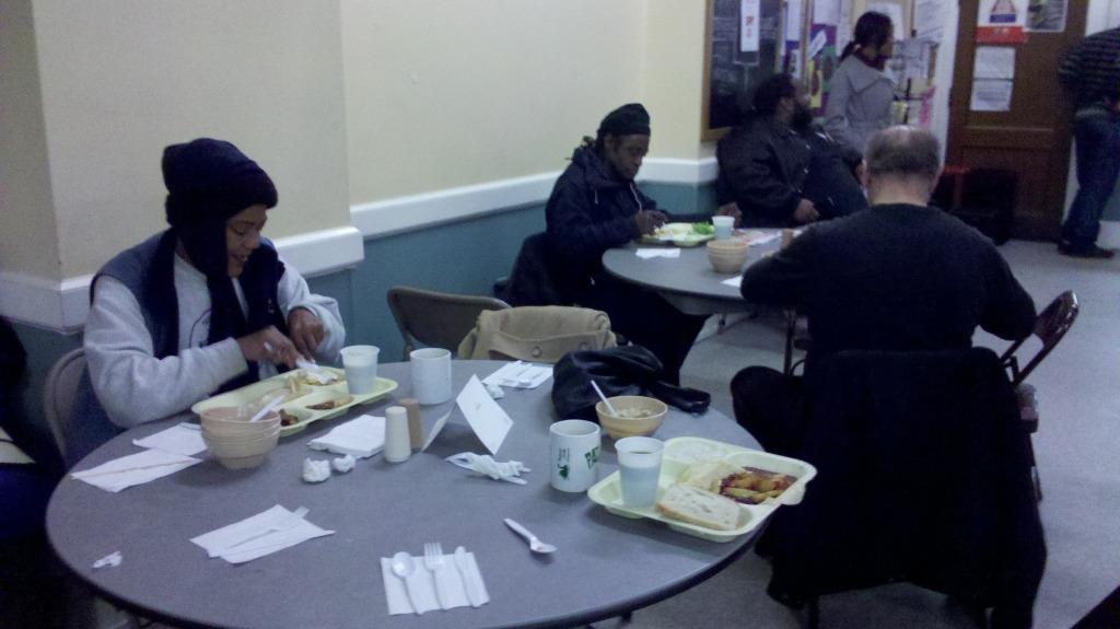 People enjoy Christmas breakfast at Miriam's Kitchen. (WTOP/Kathy Stewart)