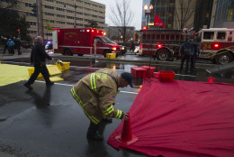 A firefighter sets up a triage area as people are evacuated from a smoke filled Metro subway tunnel in Washington, Monday, Jan. 12, 2015. Metro officials say one of the busiest stations in downtown Washington has been evacuated because of smoke.  Authorities say the source of the smoke is unknown.  (AP Photo/Jacquelyn Martin)