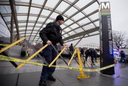 Metro Transit Police officers secure the entrance to L''Enfant Plaza Station in Washington, Monday, Jan. 12, 2015, following an evacuation. (AP Photo/Manuel Balce Ceneta)