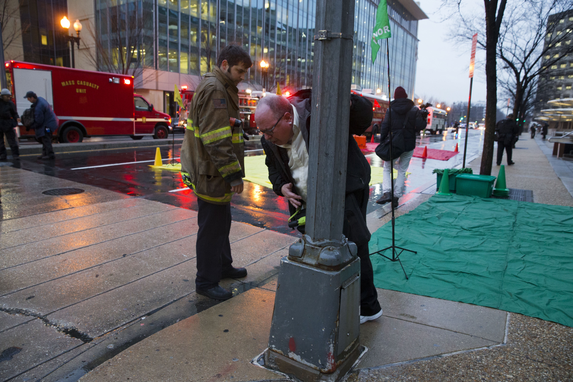 A man coughs and spits as he is evacuated from a smoke filled Metro subway tunnel in Washington, Monday, Jan. 12, 2015. Metro officials say one of the busiest stations in downtown Washington has been evacuated because of smoke.  Authorities say the source of the smoke is unknown.  (AP Photo/Jacquelyn Martin)