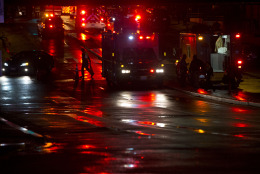Firefighters begin to remove cones from the scene after people were evacuated from a smoke filled Metro subway tunnel in Washington, Monday, Jan. 12, 2015. Metro officials say one of the busiest stations in downtown Washington has been evacuated because of smoke. Authorities say the source of the smoke is unknown. (AP Photo/Jacquelyn Martin)