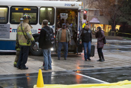 Coughing people are sorted for triage needs after being  evacuated from a smoke filled Metro subway tunnel in Washington, Monday, Jan. 12, 2015.  Metro officials say one of the busiest stations in downtown Washington has been evacuated because of smoke.  Authorities say the source of the smoke is unknown.   (AP Photo/Jacquelyn Martin)