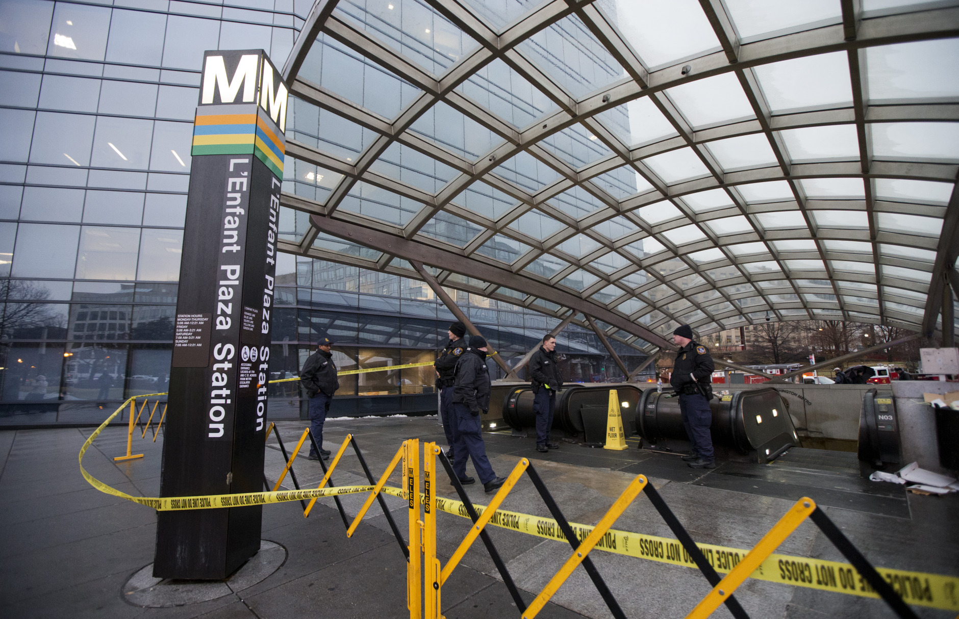 Metro Transit Police officers, secure the entrance to L'Enfant Plaza Station in Washington, Monday, Jan. 12, 2015. Metro officials say one of the busiest stations in downtown Washington has been evacuated because of smoke. (AP Photo/Manuel Balce Ceneta)
