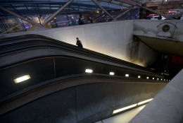 A Metro Transit Police officer walks up the escalator at L'Enfant Plaza Station in Washington, Monday, Jan. 12, 2015, following an evacuation. Metro officials say one of the busiest stations in downtown Washington has been evacuated because of smoke.  Authorities say the source of the smoke is unknown.   (AP Photo/Manuel Balce Ceneta)