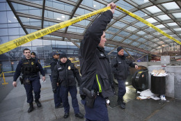 Metro Transit Police officers secure the entrance to  L'Enfant Plaza Station in Washington, Monday, Jan. 12, 2015. Metro officials say one of the busiest stations in downtown Washington has been evacuated because of smoke.  Authorities say the source of the smoke is unknown.   (AP Photo/Manuel Balce Ceneta)