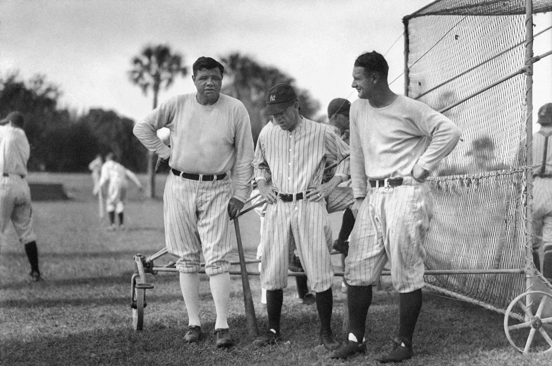 Yankees legends Babe Ruth (left) and Lou Gehrig (right) chat outside the batting cage in 1929. (AP Photo)