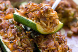 This June 6, 2011 photo shows jambalaya-stuffed zucchini in Concord, N.H.  This dish can be served with a green salad and a piece of crusty French bread to round out the meal.     (AP Photo/Matthew Mead)