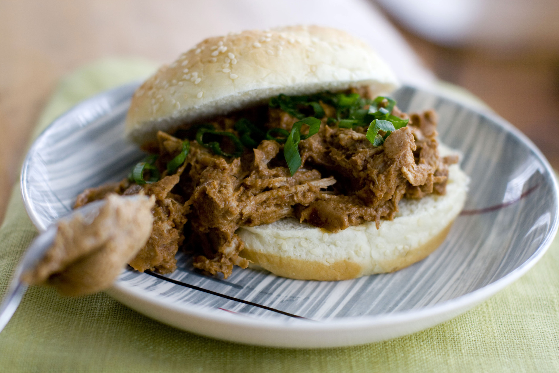 Almond butter gives a thick, rich texture and flavor to this mole-style pulled pork sandwich. (AP Photo/Matthew Mead)