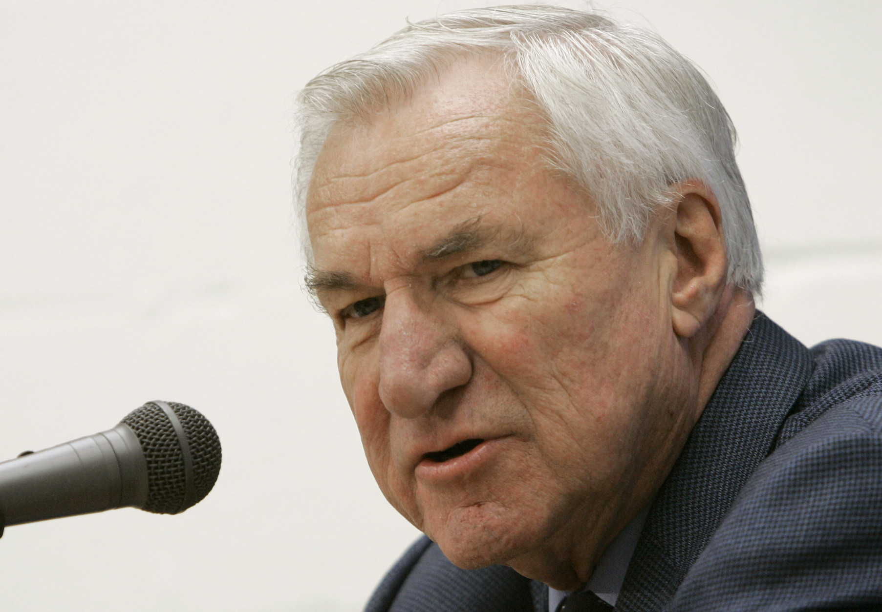 Former North Carolina basketball coach Dean Smith answers questions during a press conference in Chapel Hill, N.C., Friday, Dec. 8, 2006. - Dean-Smith-1805x1254