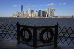 Lower Manhattan appears behind a pair life preservers on a Staten Island Ferry, in New York Harbor, Thursday, Feb. 5, 2015. The skyscrapers of Manhattan look almost close enough to touch from the waterfront of Brooklyn's industrial Red Hook neighborhood. But a lack of public transportation options makes getting from one to the other difficult. Mayor Bill de Blasio looks to change that with a plan to bring ferry service to some of New York City's waterfront neighborhoods. (AP Photo/Richard Drew)