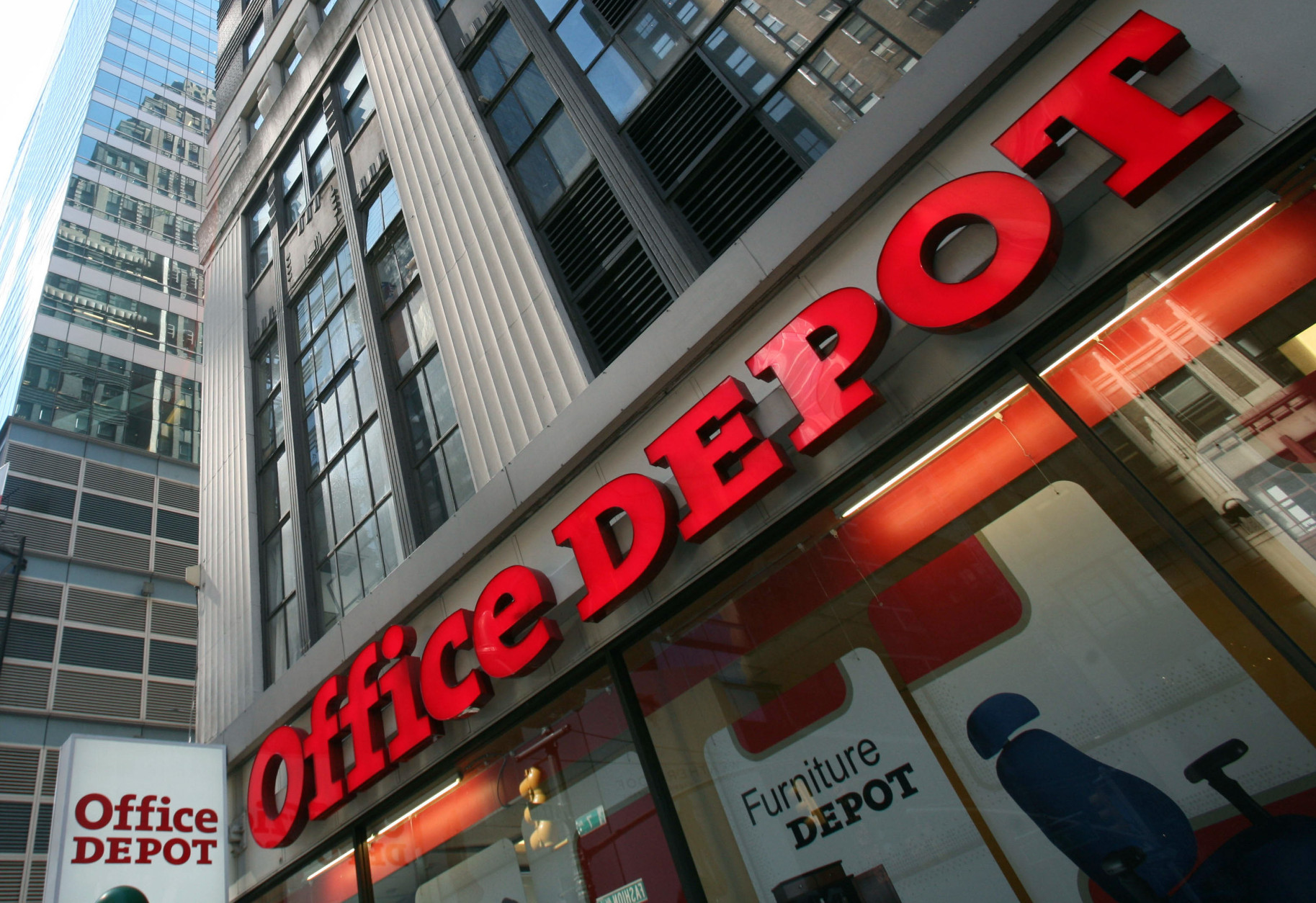 FILE - This June 2, 2008 file photo shows an Office Depot store on in New York. Staples on Wednesday, Feb. 4, 2015 announced it is buying Office Depot in a cash-and-stock deal valued at nearly $6 billion. (AP Photo/Mark Lennihan, File)