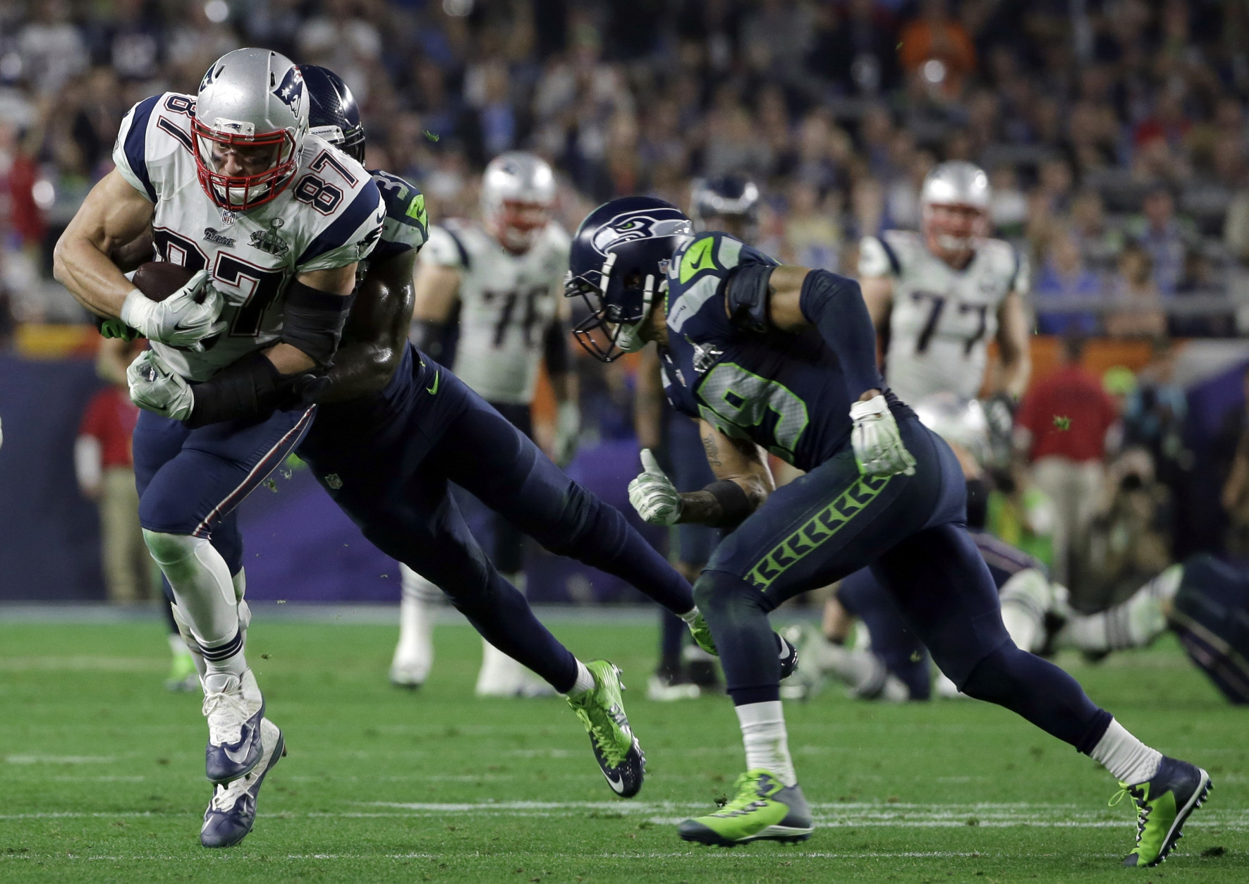 New England Patriots tight end Rob Gronkowski (87) is tackled by Seattle Seahawks strong safety Kam Chancellor (31) during the second half of NFL Super Bowl XLIX football game Sunday, Feb. 1, 2015, in Glendale, Ariz. (AP Photo/Matt Slocum)