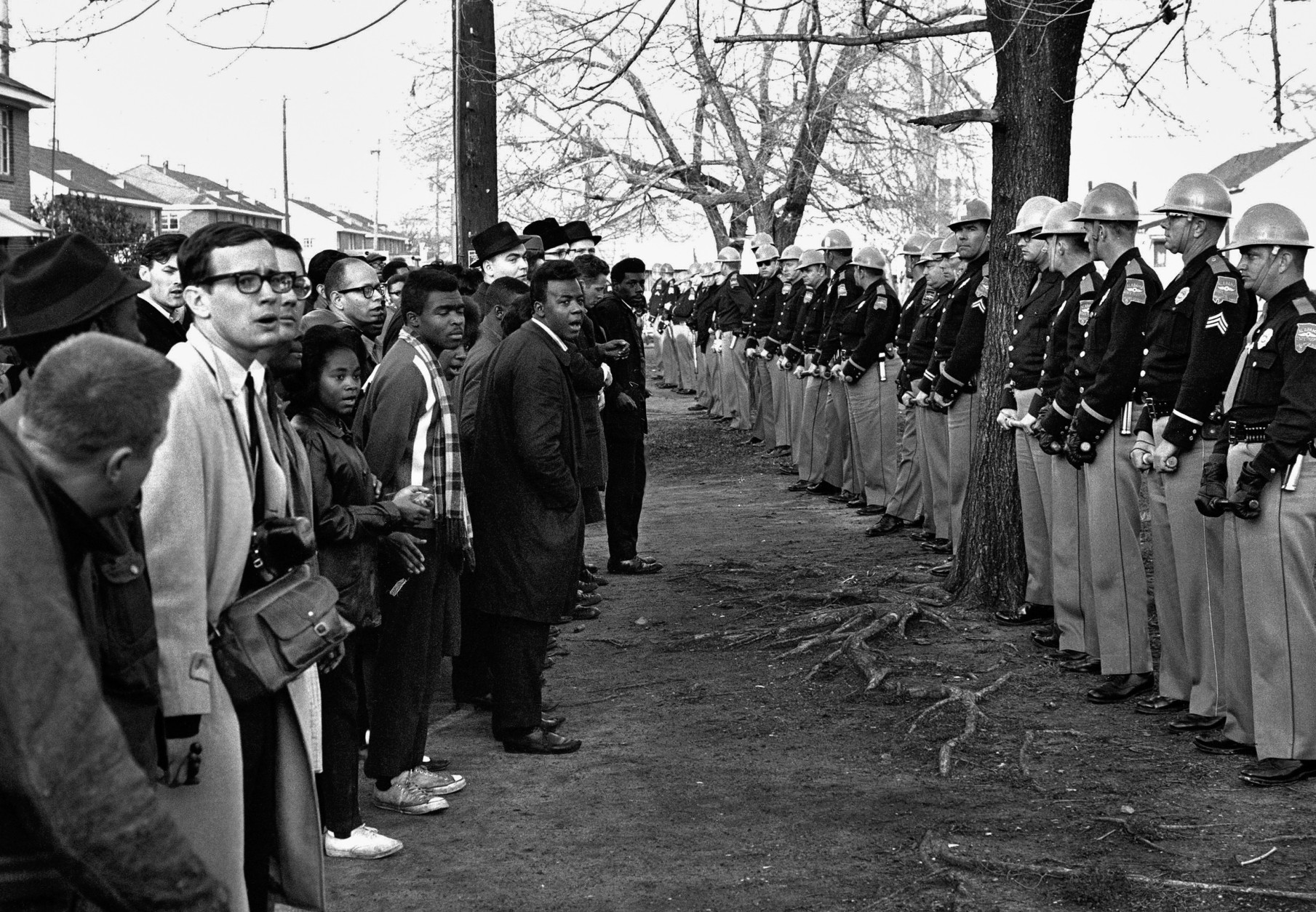 FILE - In this March 13, 1965 file photo, a line of police officers hold back demonstrators who attempted to march to the courthouse in Selma, Ala. Police kept the demonstrators hemmed up in a square block area where they attempted several times to break through. (AP Photo/File)