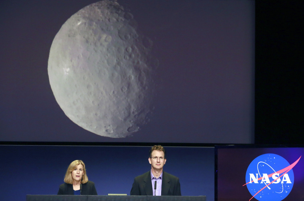 Robert Mase, right, project manager for the  Dawn mission at Nasa's Jet Propulsion Laboratory, speaks at news conference, with Carol Raymond, deputy project scientist at JPL, left, at JPL in Pasadena on Monday, March 2, 2015. NASA's Dawn spacecraft is scheduled to slip into orbit around the dwarf planet Ceres on Friday, the last stop in a nearly eight-year journey. (AP Photo/Nick Ut)
