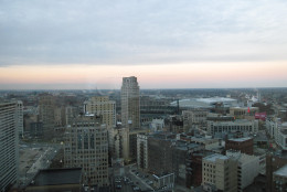 This Dec. 4, 2014 photo shows downtown Detroit at dusk as seen from an upper floor of the Westin Book Cadillac, the city's fanciest hotel, which has condo apartments on the top floors. The  4,470-square-foot penthouse suite on the 29th floor will be priced close to $2 million when it comes on the market, and real estate broker Jerome Huez says it will be the city's most expensive apartment. Elsewhere around the city, thousands of houses have been abandoned and many will be foreclosed upon this spring, then eventually auctioned off for $500 apiece. (AP Photo/Beth J. Harpaz)