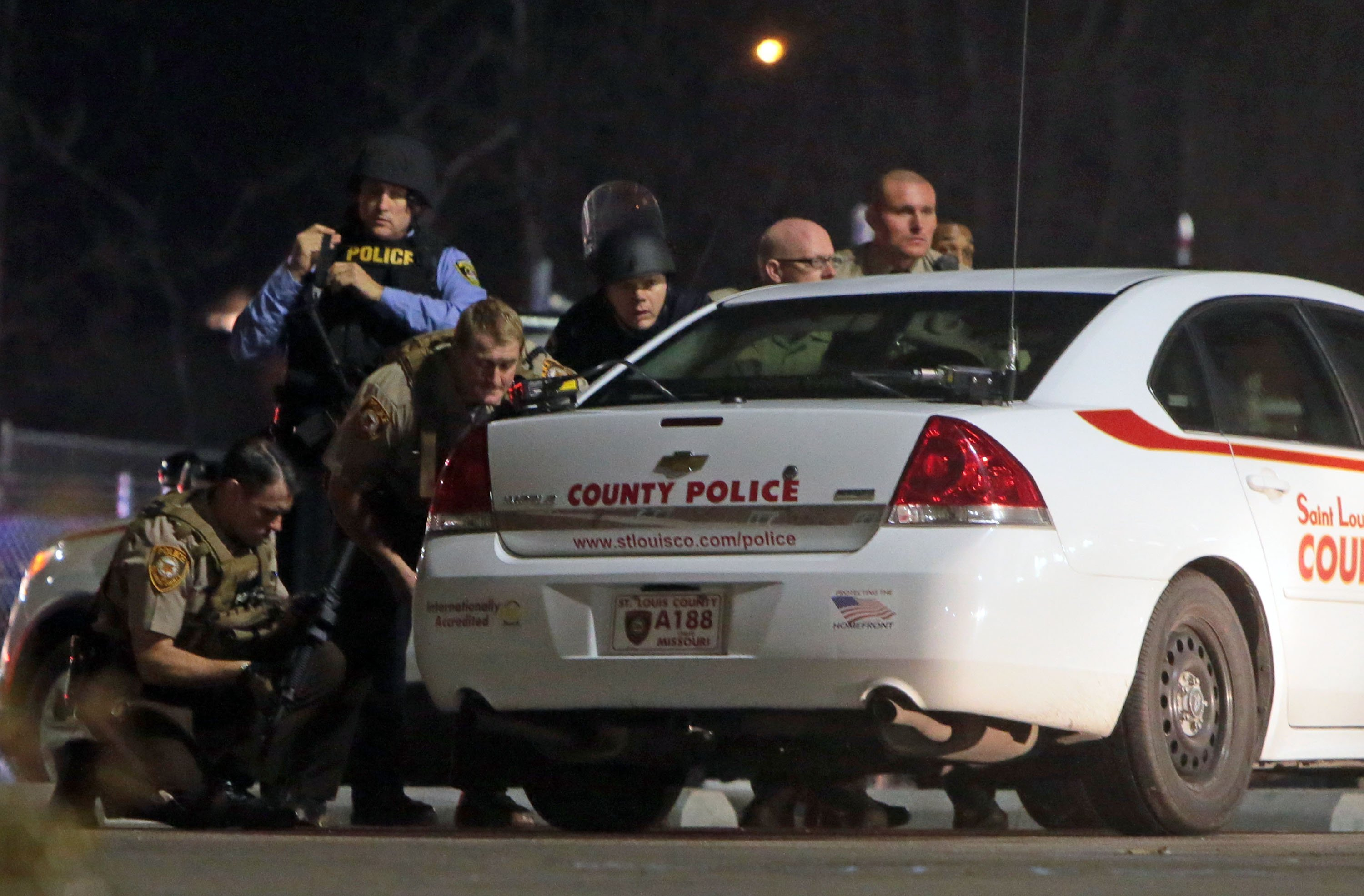 Photos: 2 officers shot at protest outside Ferguson police station