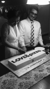 Katie Hendrickson and her fiancé aren't the only ones to have an &pizza inspired wedding. Here, &pizza employees Ashaad and Alejandra, who met on the job, cut into their wedding cake, modeled after the local chain's to-go boxes. (Courtesy &pizza)