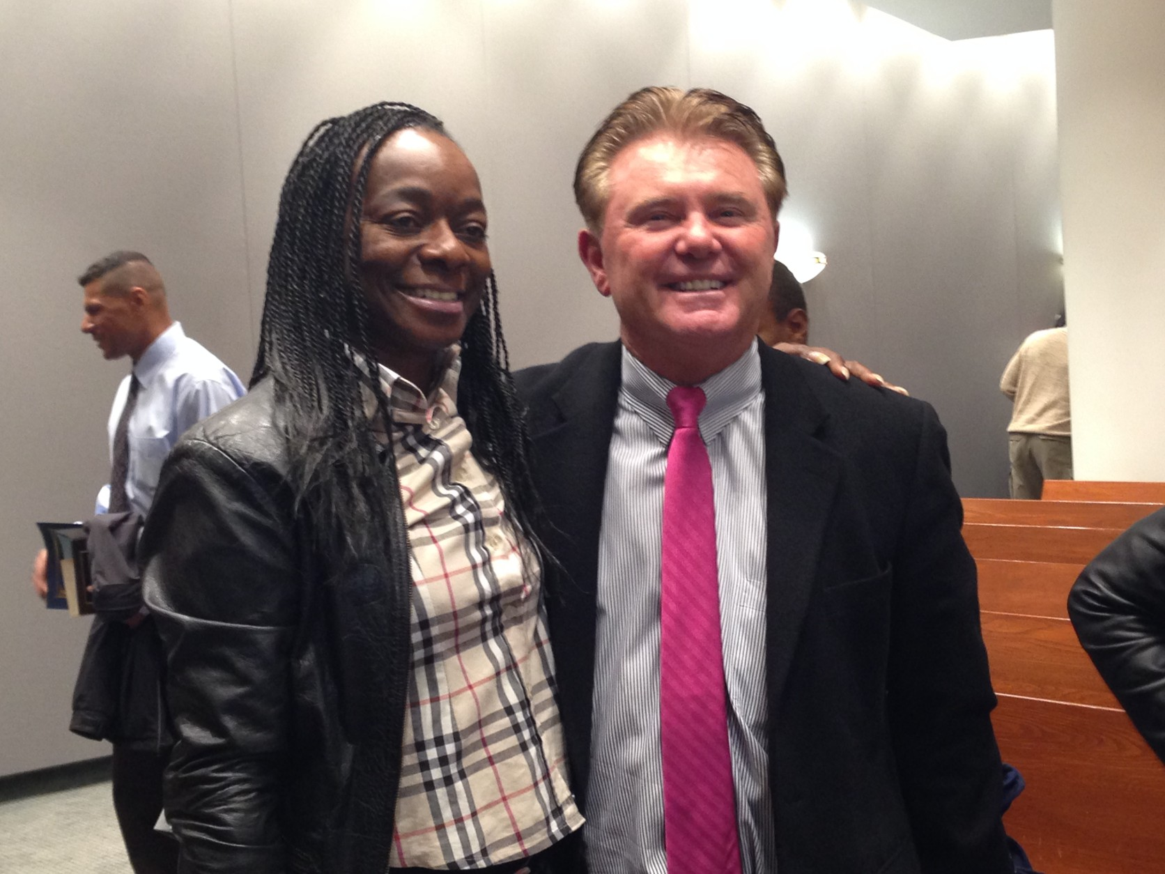 Shuletta Moore, a recovering drug addict who graduated from the Montgomery County Drug Court in 2010. She was the guest speaker at the November 2014 graduating class on the 10th anniversary of Drug Court. She is pictured here with  Maryland State's Attorney John McCarthy. (WTOP/Jamie Forzato)