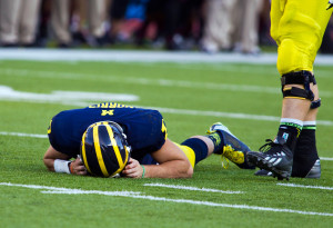 Michigan coaches and the athletic department came under fire for leaving their concussed quarterback, Shane Morris, in a game last season. (AP Photo/Tony Ding)