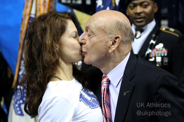 Dick Vitale and Ashley Judd kiss before Kentucky game