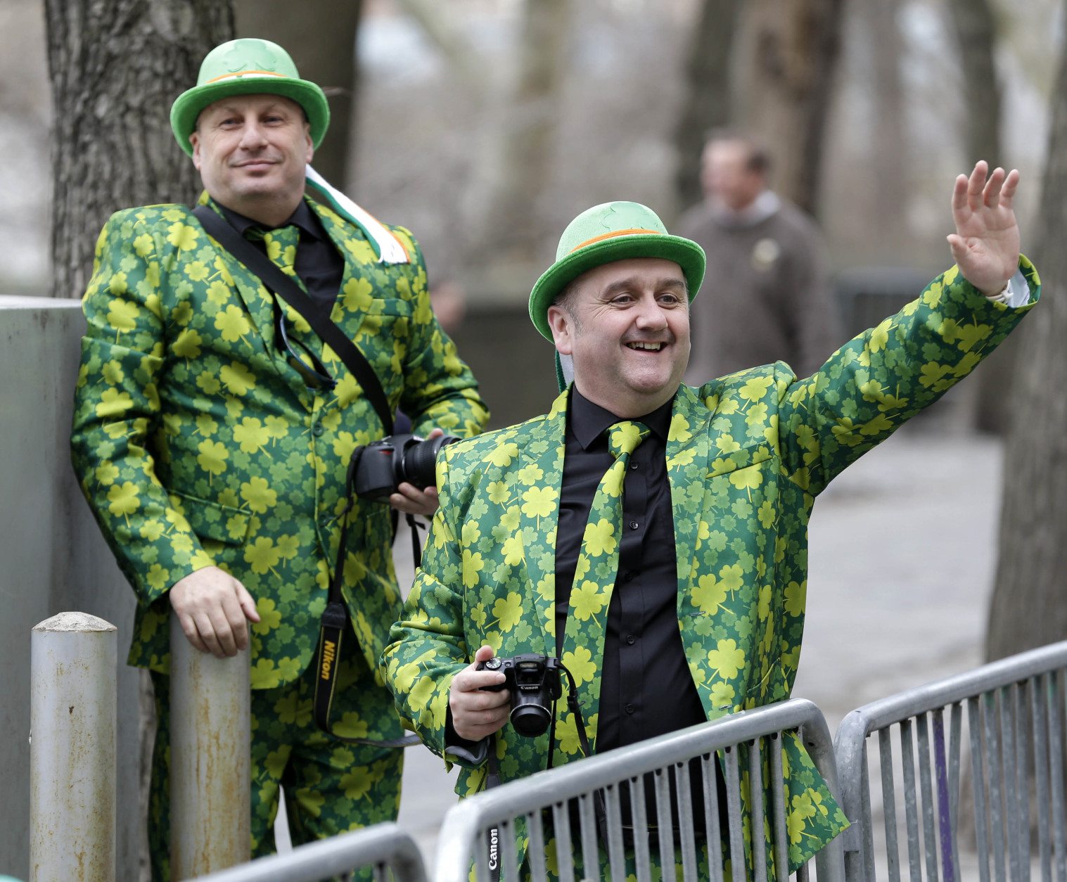 Neil Martin, right, and Martin Brown, both from Belfast, Ireland, watch the St. Patrick's Day Parade in New York, Tuesday, March 17, 2015. (AP Photo/Seth Wenig)