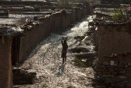 A girl, whose family was displaced from a Pakistani tribal area where security forces are fighting militants, fetches clean water in a slum in Islamabad, Pakistan, on Monday, March 16, 2015. (AP Photo/B.K. Bangash)
